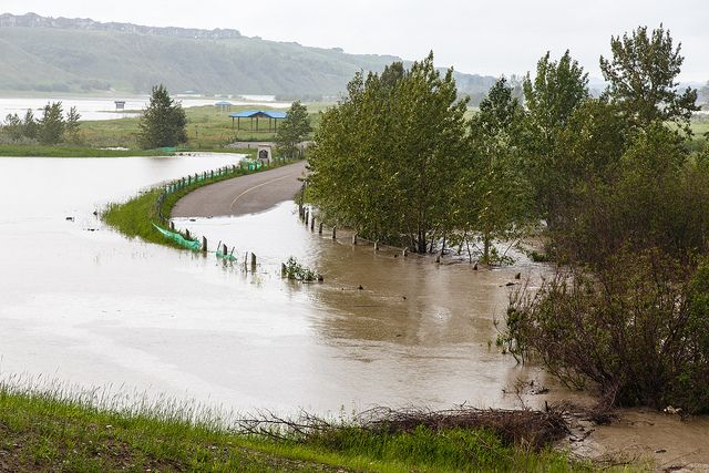 A submerged road that run under Hwy 22x in Fish Creek Provincial Park in Calgary during the Alberta floods of 2013.