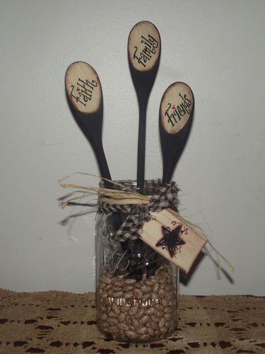 Canning jar spoon holder with hand painted wooden spoons, tea dyed tag, and pinto beans.