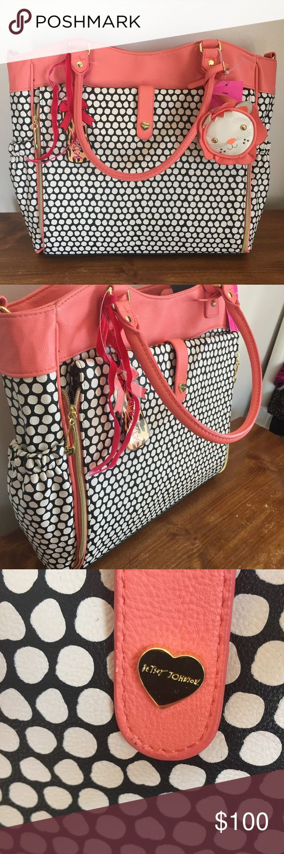 New! Betsey Johnson Diaper Bag Super cute Betsey Johnson Diaper bag! Black and white pattern with coral accents. Lion coin purse is adorable. Adjustable crossbody straps. Make an offer! Betsey Johnson Bags Baby Bags
