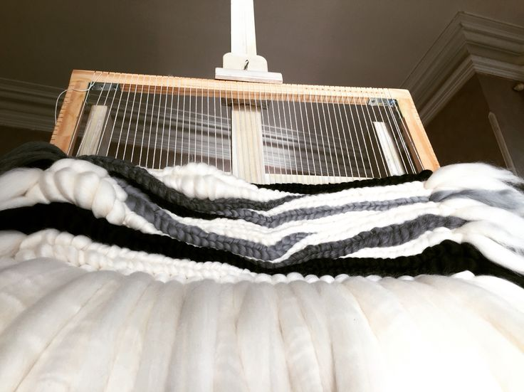 Large woven wall hanging on the loom