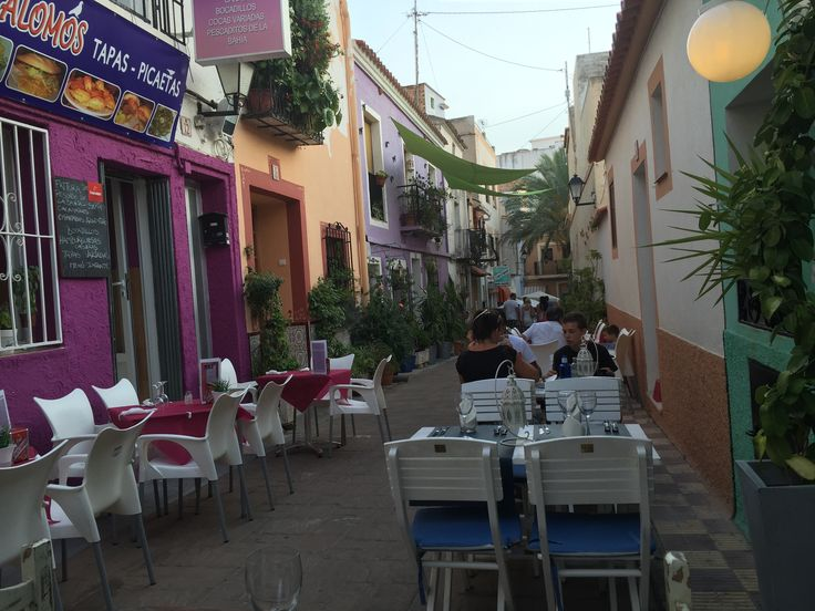 The Colourful Narrow Street In The Old Town With Restaurants & Bars. #BeautifulRestaurantsCalpe