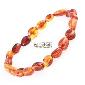 This may be an alternative to assist with general aches and pains,arthritis and eczema. This 18cm Bambeado amber adult Cognac bean bracelet is made from large bean shaped amber pieces that have been polished so that there are no sharp edges. The amber beads bracelets are mounted on a strong elastic thread and are gorgeous on. While Bambeado amber comes in several colours, the colour is just a matter of personal choice.