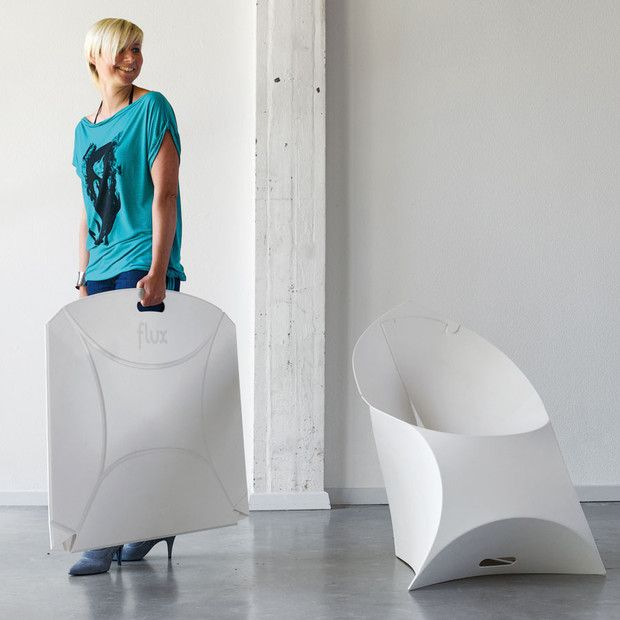Flux Chair from Touch of Modern. Folds flat for easy stacking and storing.