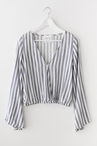 Denim Blue and Ivory long sleeve striped top with a flattering Vneckline and bell sleeves. Fitted and elasticated bottom. Made with lightweight woven non-stret