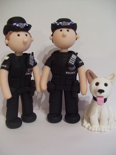 Two police officers and their dog - all ready to tie the knot.