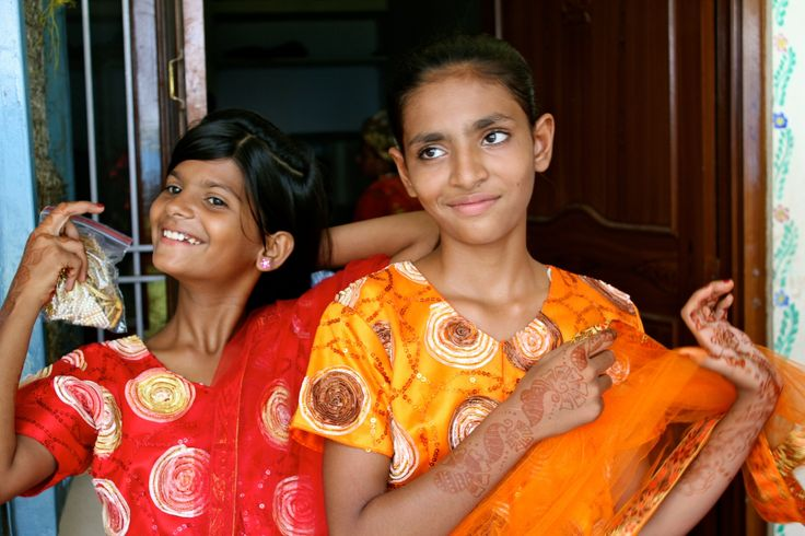 Girls in Red and Orange at the Tushita Foundation Play, Amber, Rajasthan, India