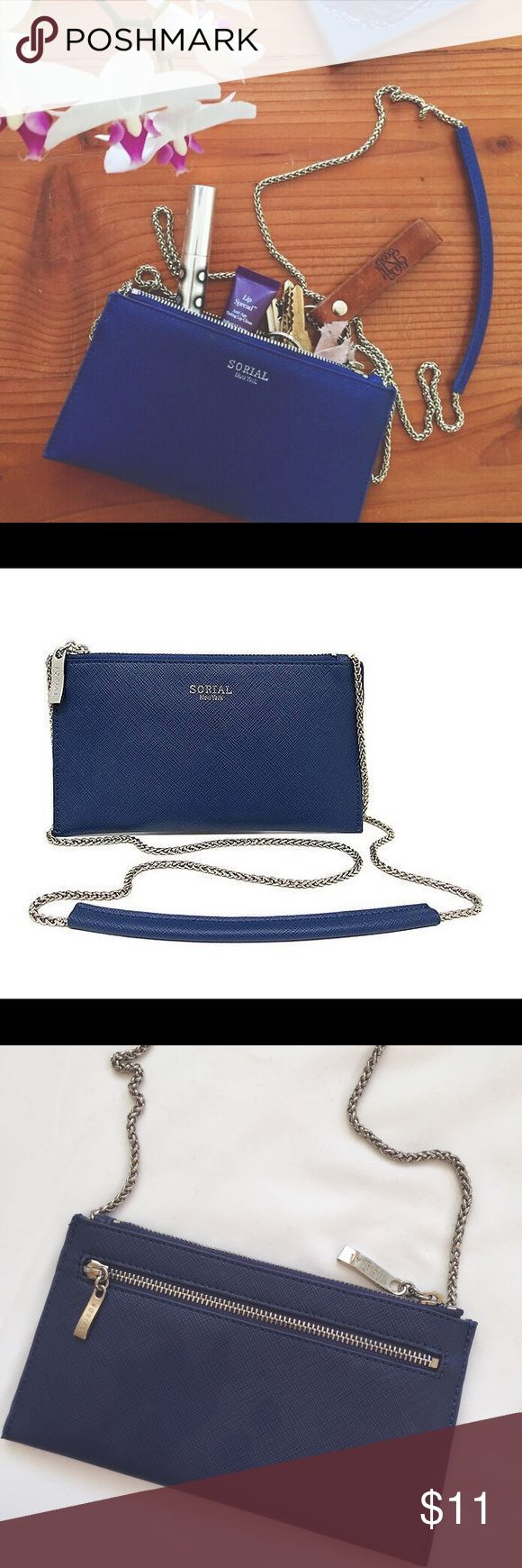 NWOT Sorial New York navy clutch Featured in the Popsugar Musthave box- this gorgeous navy clutch has never been used. It's features include a zip pocket on the outside, leopard print lining, and a beautiful silver chain. Perfect for toting around a few essentials or for organizing the items in your larger bags. Sorial Bags Clutches & Wristlets
