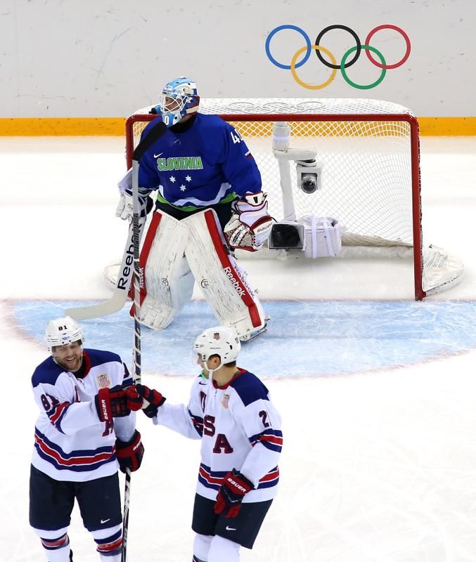 FEBRUARY 16: Phil Kessel #81 of the United States celebrates with James van Riemsdyk #21 after scoring his second goal of the first period against Luka Gracnar #40 of Slovenia during the Men's Ice Hockey Preliminary Round Group A game on day nine of the 2014 Winter Olympics at Shayba Arena. #TeamUSA