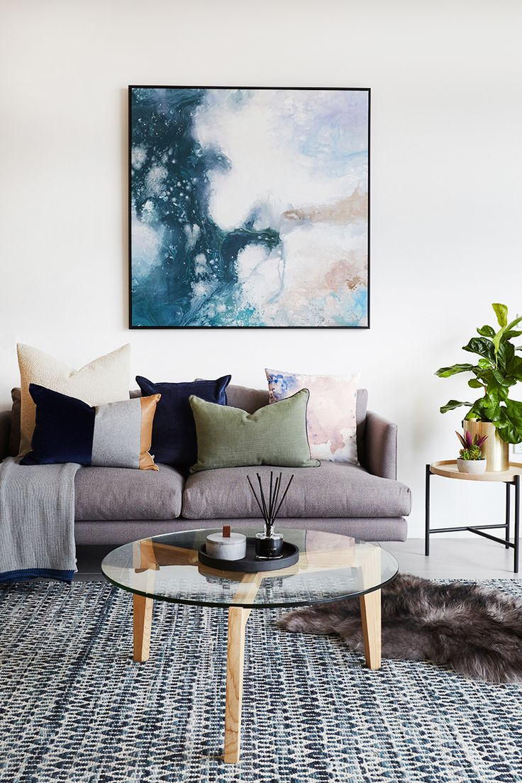 Grey sofa with large watercolour art - UNITED INTERIORS' NEW MELBOURNE SHOWROOM — Adore magazine