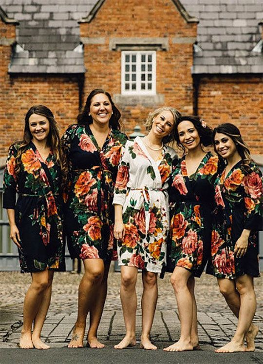 These robes are made from cotton instead of silk...more comfortable and make for more inexpensive / cheap bridesmaids robes. Plus they look just as good and clean better. She sells these in a set of two or more. The bride gets the white one and bridesmaids' are navy (unless you want something different than white for the bride...you get to pick). There are a bunch of other designs, too.