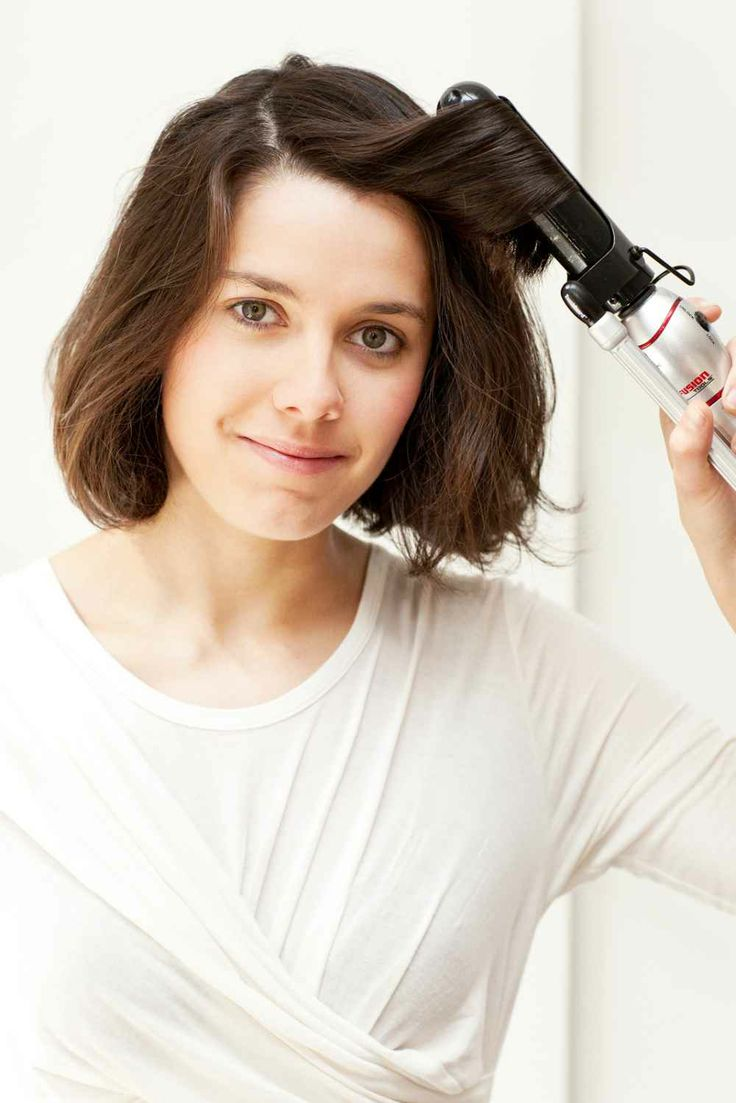 Take a one-inch section of hair at the front, and, using a large barrel curling iron, curl the hair outward.      Photographed by Mark Iantosca