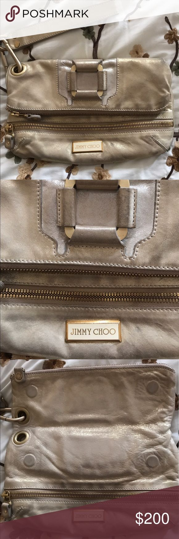 """😍Jimmy Choo """" Marin """" clutch PRICE FIRM ! Love this clutch ! I bought it preloved and it has been well kept . Fold over with magnetic and zipper closure .With removable wristlet in a beautiful metallic distressed gold color leather  . Tan suede interior . Gold colored hardware with minor chipping in a few spots .In good preowned condition with normal signs of wear . Jimmy Choo Bags Clutches & Wristlets"""