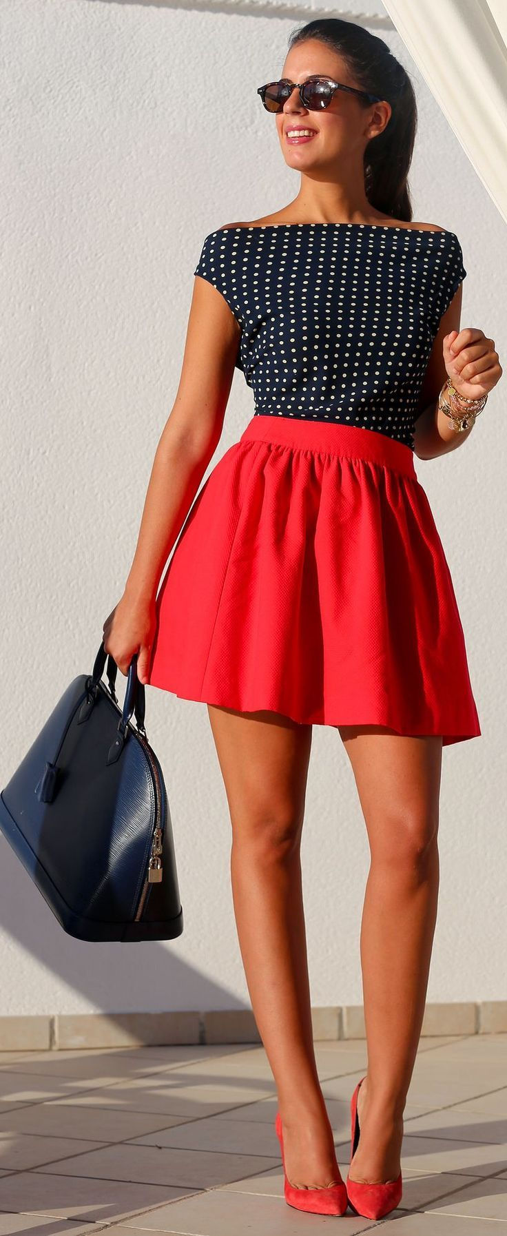 Shop this look on Lookastic:  http://lookastic.com/women/looks/sunglasses-sleeveless-top-bracelet-skater-skirt-satchel-bag-pumps/9683  — Dark Brown Sunglasses  — Navy and White Polka Dot Sleeveless Top  — Gold Bracelet  — Red Skater Skirt  — Navy Leather Satchel Bag  — Red Suede Pumps