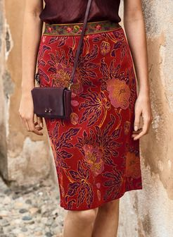 Inspired by an antique kimono, grand-scale blooms thrive on the shapely pencil skirt. Jacquard knit of pima in rich hues of plum, magenta, gold and persimmon, with a stunning contrast patterning at the banded waist.