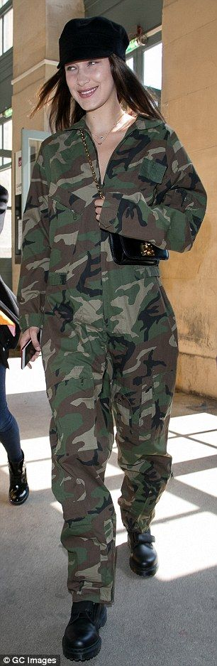 Bella Hadid wears baggy camouflage jumpsuit in Paris | Daily Mail Online