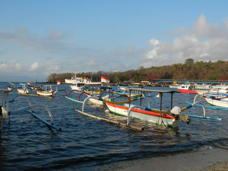 Padang Bai - a pretty, working harbour shared by fisherman and cargo ships & passenger ferries. The port tourists leave from to get to Lombok & the gillis.