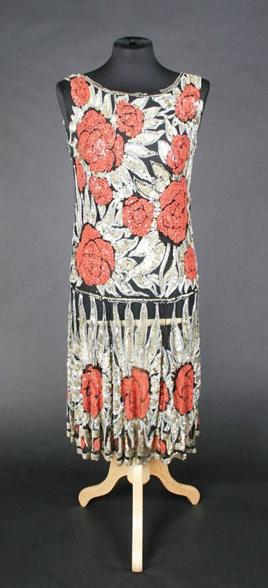 French circa 1924, of black net ornately covered with golden and coral coloured sequins and pearlized bugle beads in an allover floral design - would be worn with an underslip Private collection