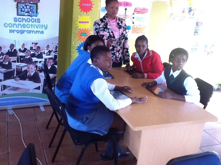 Learners using tablets to learn mathematics and life science.
