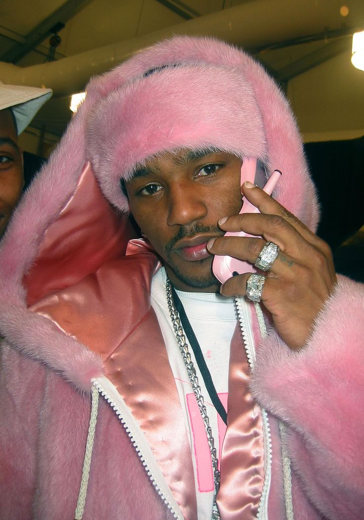 Who wore it better: Cam'ron backstage at the 2003 Baby Phat runway show, or Nicki Minaj?