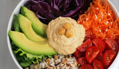 The veggie whole bowl is topped with natural, organic, whole foods. It's vegan and gluten-free! A dish that fits in perfectly with any time of the year. Fresh lettuce, crunchy carrots, raw cabbage,