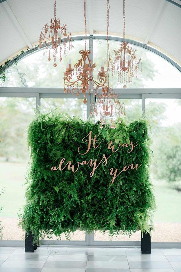 greenery and copper ceremony backdrop