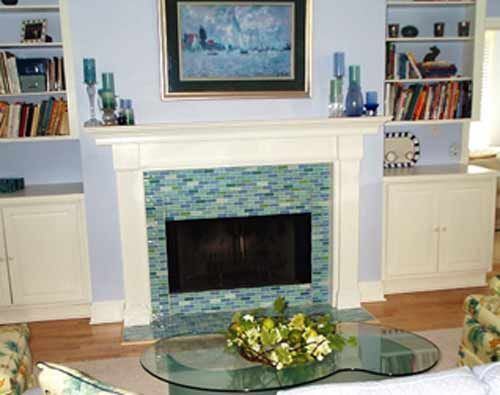 A fireplace hearth after elegant its transformation with Susan Jablon's  mosaic subway glass tiles.