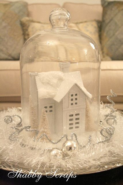 cute great idea. Get cheap christmas village from Dollar Store spray paint white place under dome. Brilliant!