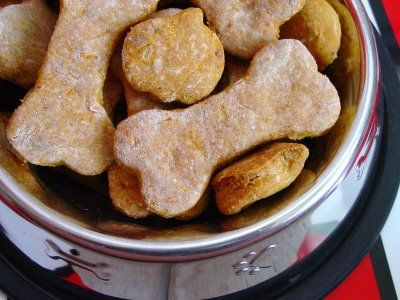 Carrot & Cheese Dog Treats...1 1/2 c. all-purpose flour,  1 1/2 c. whole wheat flour,  2-3 tbsp. grated dried cheese (Parmesan),  1/2 lb. lean ground beef, cooked and finely minced (or one small can of tuna in water-do not drain),  1 large carrot, peeled and finely grated,  1/2 tsp. garlic powder,  2 large eggs,  1/2 c. beef or chicken broth (if you use tuna, you don't need the broth)