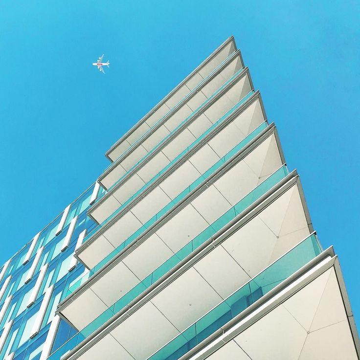 White and blue triangles with plane #architecture #geometry #rsa_minimal #minimalmood #igerslombardia #igersitalia