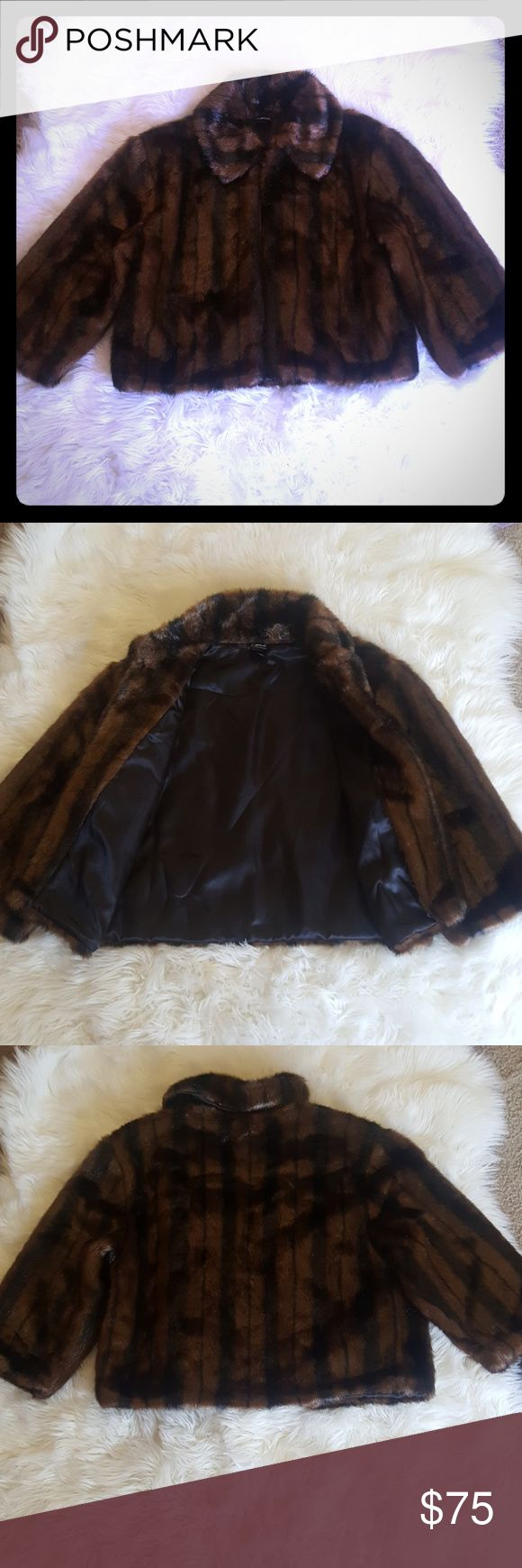 Faux fur jacket Soft chocolate and black faux fur jacket. With quarter length sleeves a collar and a smooth lining on the inside.  Has on clasp at the top near the collar for a cape effect when buttoned. You can put your arms in or simply drape it over your shoulders like the stars do. Cejon Jackets & Coats