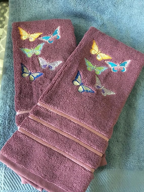 A set of 2 Purple Hand Towels Embroidered with Butterflies