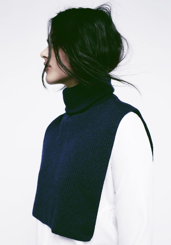 Black hair, navy roll neck & white shirt