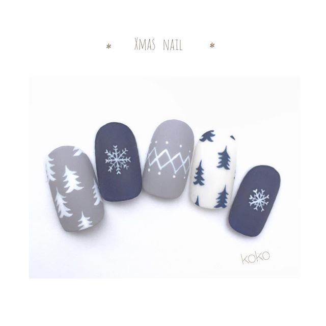 Gray, white, and blue festive (christmas tree) nails.