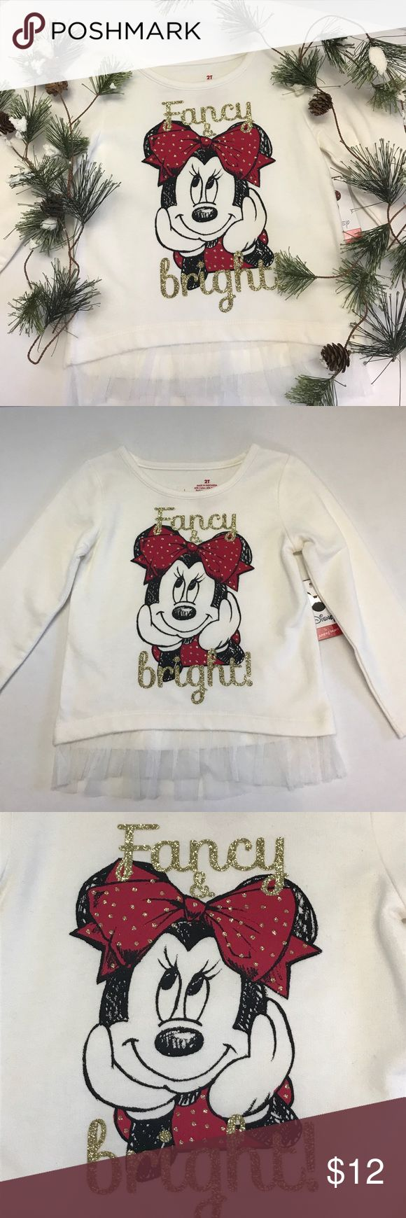 "Minnie Mouse Fancy & Bright Sweatshirt This cute little sweatshirt features Minnie Mouse daydreaming of the Christmas season.  She is dressed in red with glitter gold polkadots.  The sweatshirt also has the words "" Fancy & Bright"" in gold glitter around Minnie.  There is a little ivory tulle added to the hem of the sweatshirt for a little added touch!!  Sweatshirt is a soft cotton poly blend (60%/40%).  Super cute & a great Black Friday weekend deal!!  NWT Disney Shirts & Tops Sweatshirts…"