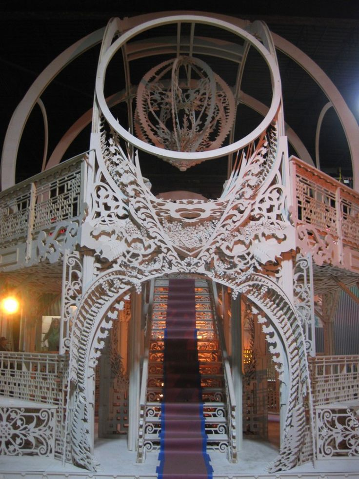 "So this entire structure is created out of flat sheets of pressure treated plywood. Very detailed & intricate, the structure is a full two-story ""gazebo"" with fantastic design elements. Layers upon layers of intricately cut sheets create this dramatic effect. And a splash of theatrical lighting doesn't hurt any either!"