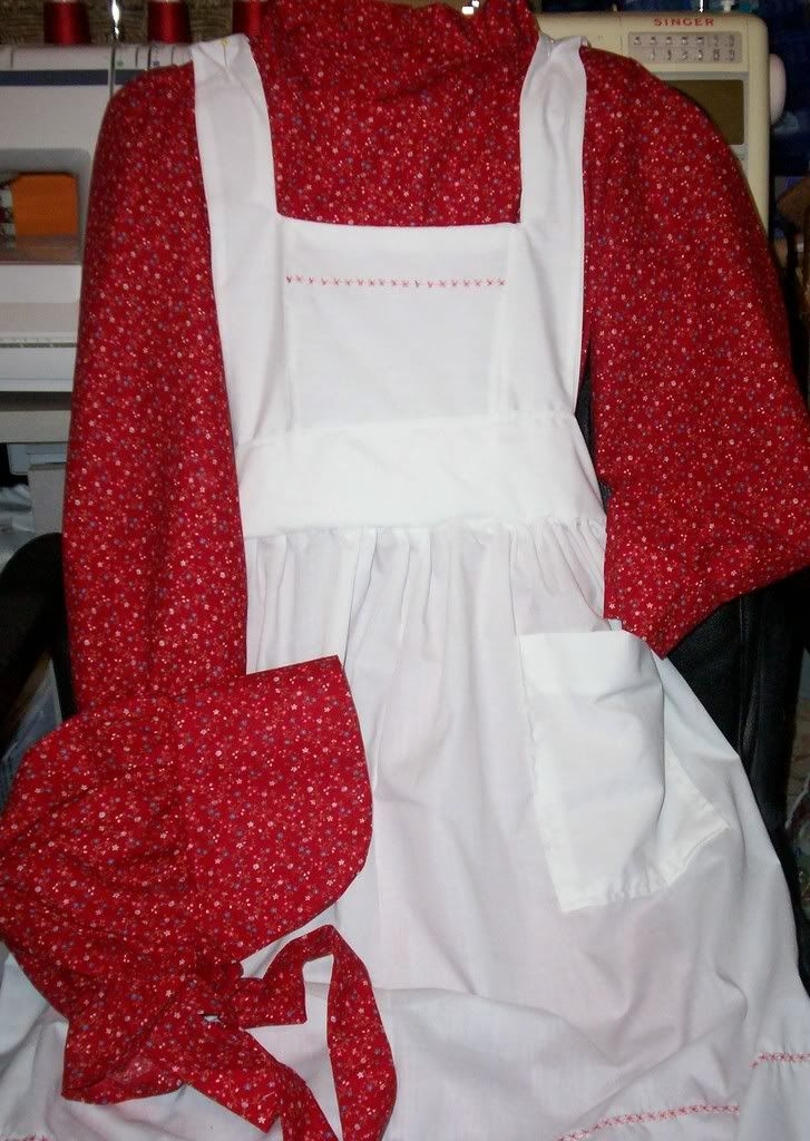 """Arletta Murdock in """"A Christmas Promise"""" receives a red calico dress with a white pinafore like this one found on:"""