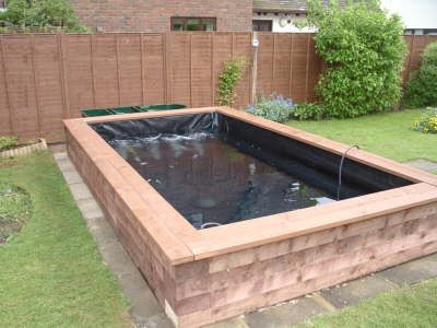 17 best garden deck ponds images on pinterest ponds for Above ground fish pond designs