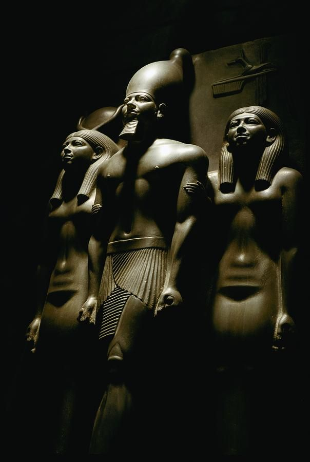 Triad statue of pharaoh Menkaura, accompanied by the goddess Hathor (on his right) and the personification of the nome of Diospolis Parva (on his left). Material:Graywacke. Dimensions:Height 63 cm Width 47 cm