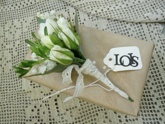 Ladies buttonhole of spray roses