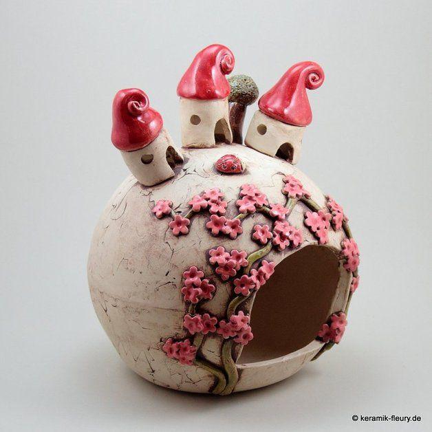 http://de.dawanda.com/product/72484431-Keramik-Windlicht-Wichtelhausen-Licht