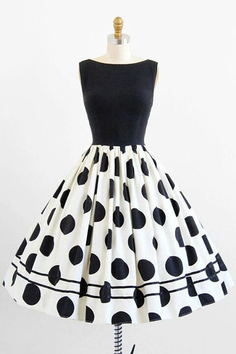 I adore the polka dots and a-line cut. I'd add a pop of color with a belt or shoes or a statement necklace.