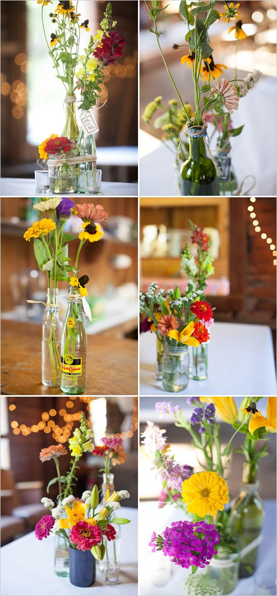Mixed bottle centerpieces with an assortment of wild flowers. Even this color range is good for you. (minus the red)