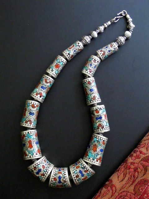 Nepal | Contemporary necklace handcrafted by Tibetan jewellery artistans living in exile in Nepal | Silver inlaid with turquoise, lapis lazuli and red coral | This necklace is a replica of older traditional pieces.
