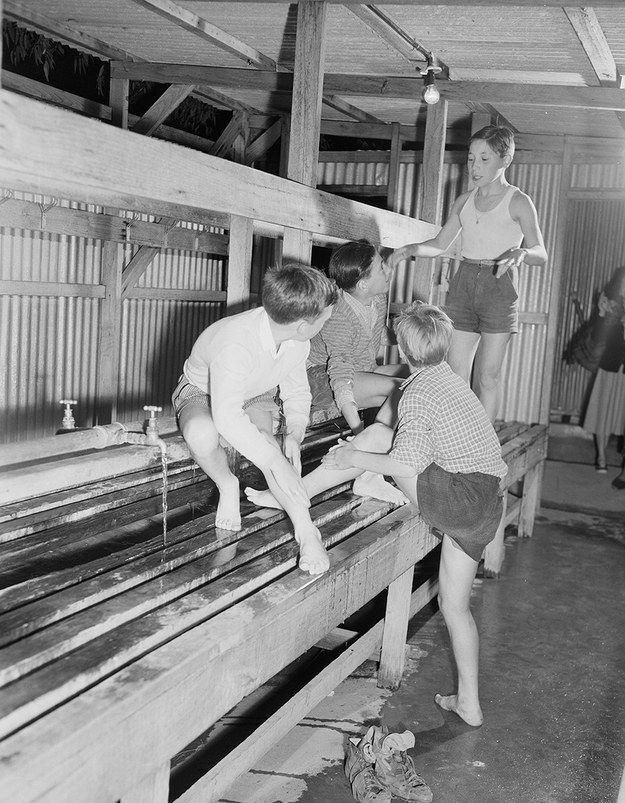 Communal washing facilities at Bonegilla, Victoria, 1949.