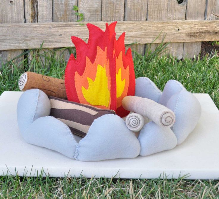 Host a camp out! Kiddos can pretend to go camping and gather around the fire with this Felt Campfire Pretend Play 6 Piece Set ($59). It even includes a felt faux stone fire pit — sweet!