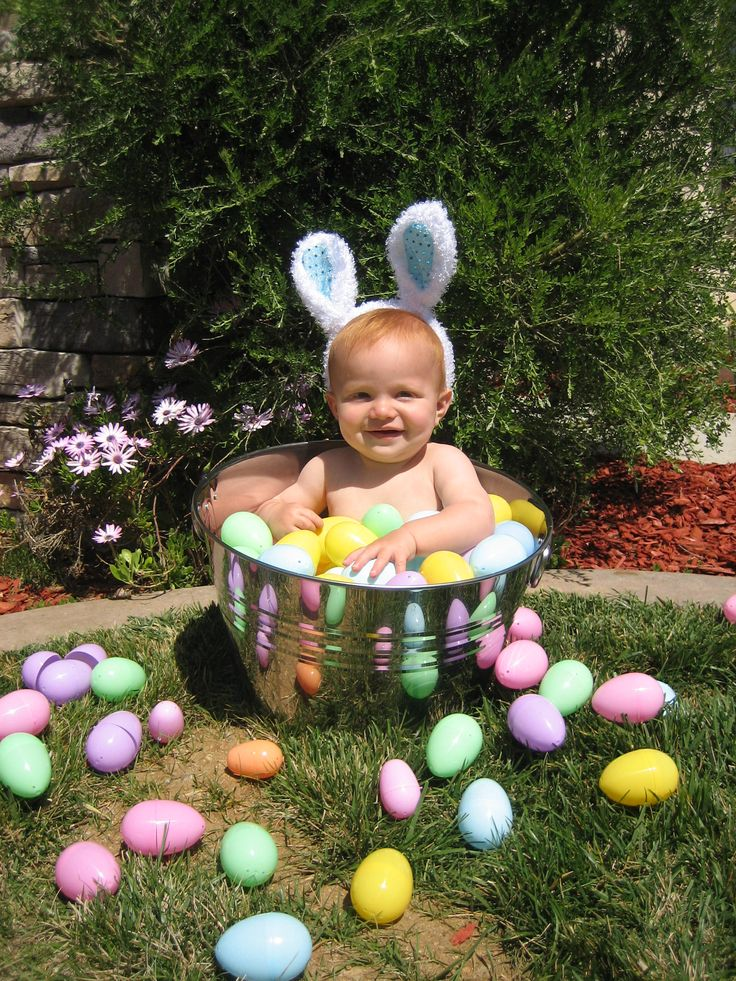 using a large wine bucket and plastic eggs (and a cute baby) you can have the perfect at home easter photo shoot