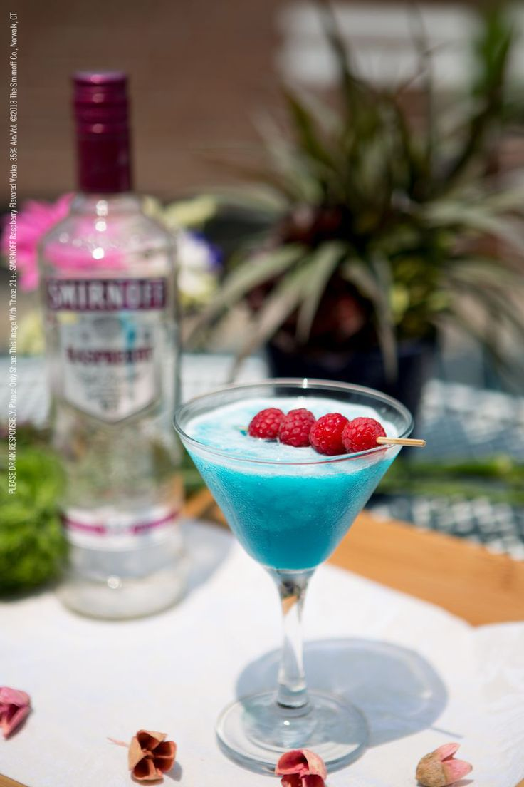 Smirnoff® Frozen Blue Raspberry drink recipe with 1.5 oz Smirnoff® Raspberry Flavored Vodka, .5 oz Blue Curacao, .5 oz orange juice, .5 oz lime juice, .5 oz sour mix.  Combine all ingredients in a blender with ½ cup ice; blend until smooth. @brifutrell08