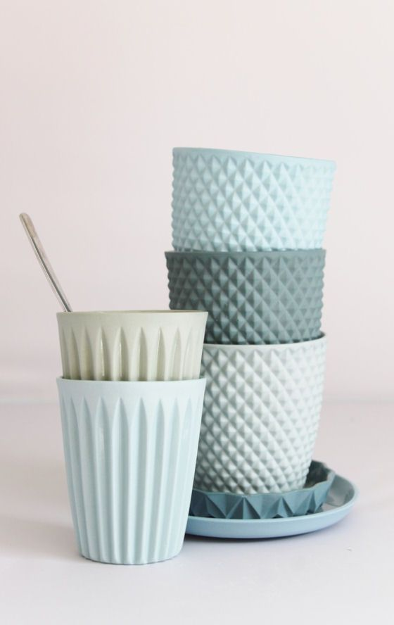 Geometric patterned ceramic cups by Dutch ceramic artist Lenneke Wispelwey in shades of blue