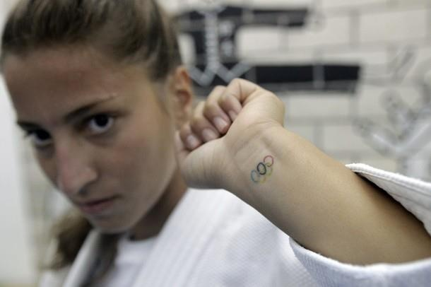 Lebanese Judo champion Karen Shammas flashes the olympic rings tatooed on her forehand at a sport club in Adma north of Beirut on July 13, 2012. Shammas will represent her country at the London 2012 Olympic games. AFP PHOTO / JOSEPH EID (Photo credit should read JOSEPH EID/AFP/GettyImages) 2012 AFP http://fb.com/WeAreLebanon