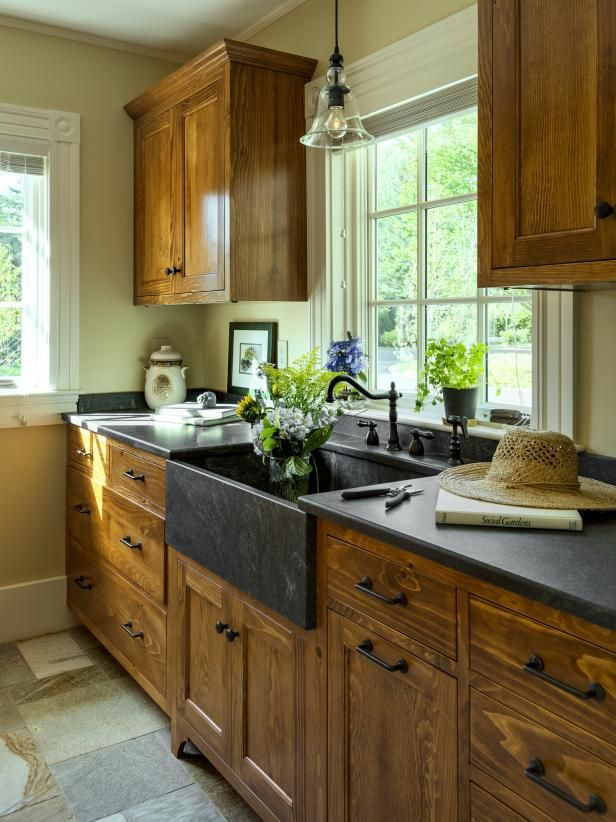 Check out the gorgeous white pine cabinets and dark stone farmhouse sink in this cottage-style kitchen on HGTV.com.